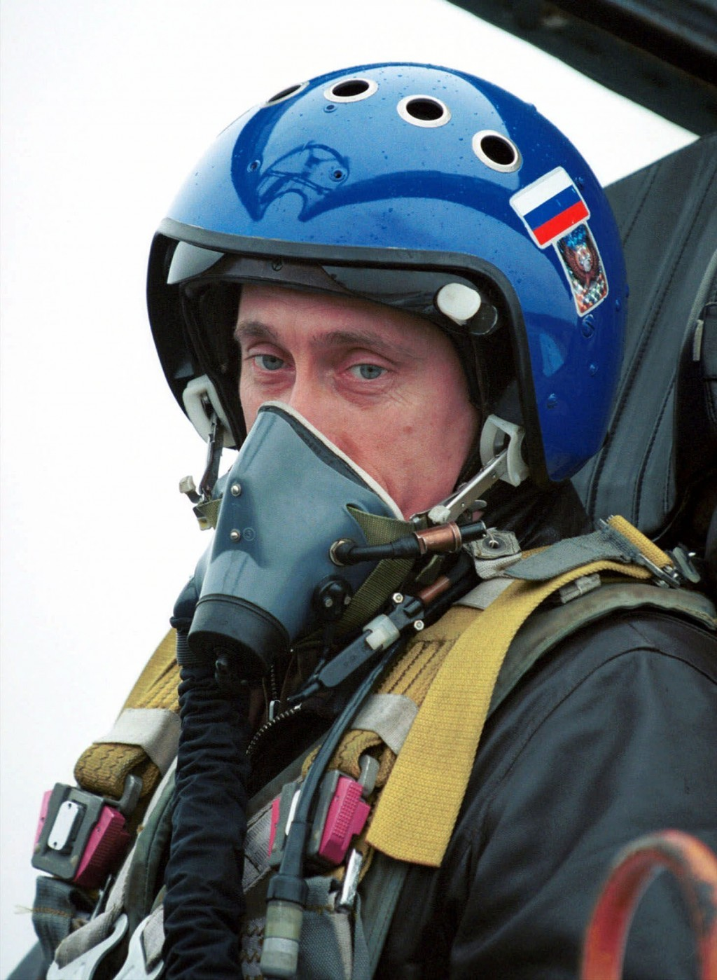 FILE - In this file photo taken on Monday, March 20, 2000, Russian President Vladimir Putin, wearing a blue helmet and an oxygen mask, sits in Su-27 f