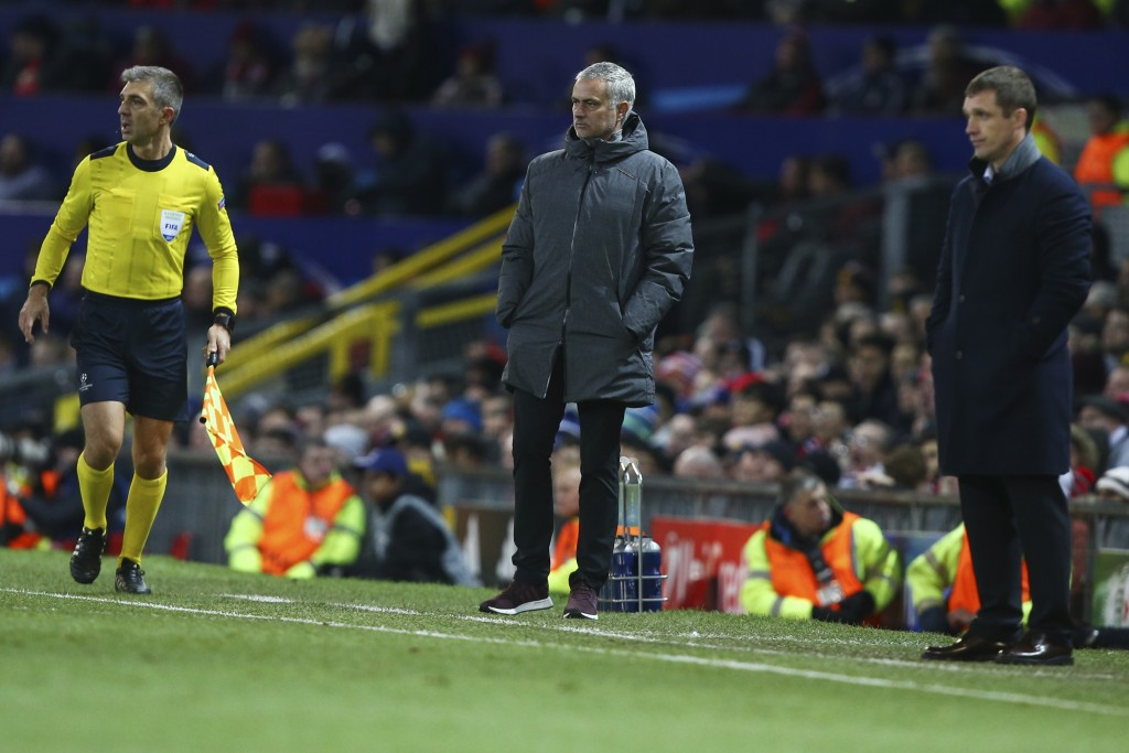 Manchester United's head coach Jose Mourinho, center, and CSKA's head coach Viktor Goncharenko, right, watches their teams during the Champions League