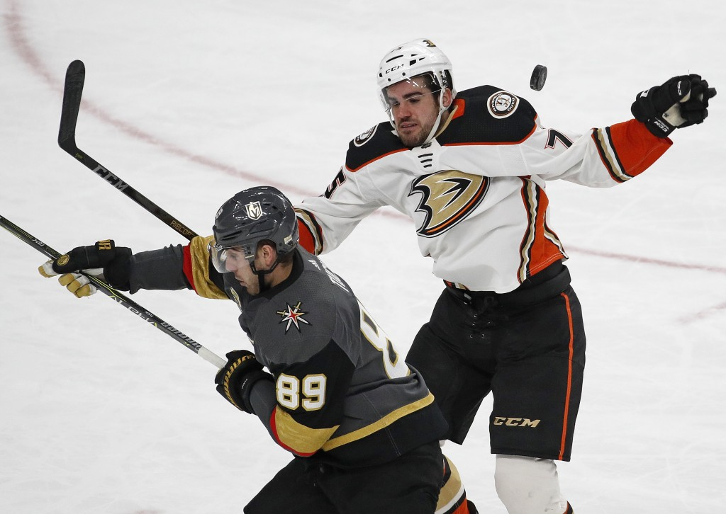 Vegas Golden Knights right wing Alex Tuch, left, and Anaheim Ducks defenseman Jaycob Megna battle for the puck during the third period of an NHL hocke