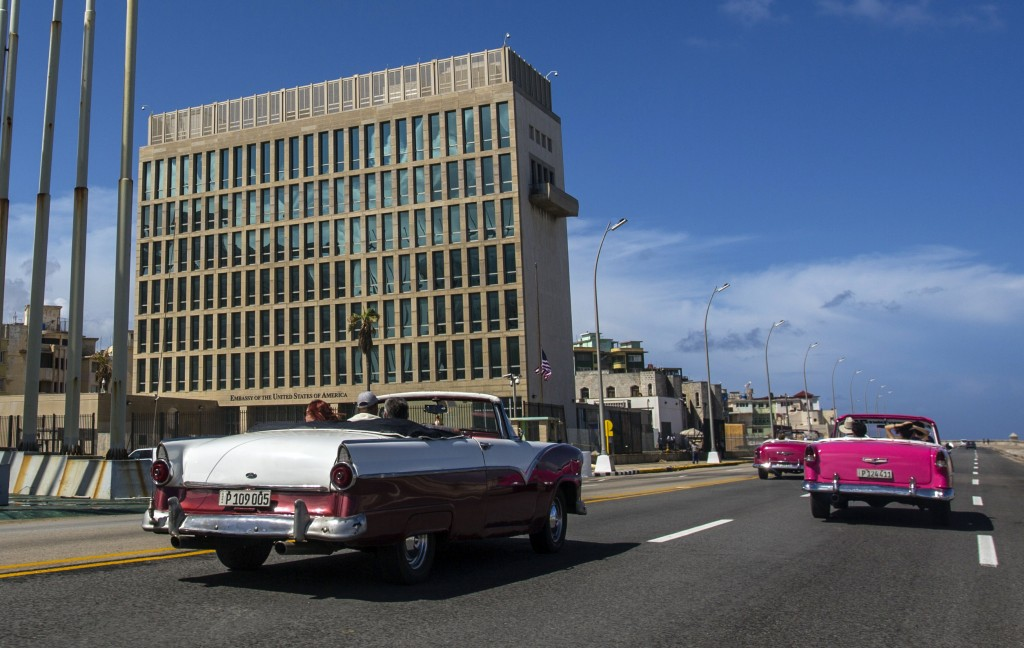 FILE - In this Oct. 3, 2017, file photo, tourists ride classic convertible cars on the Malecon beside the United States Embassy in Havana, Cuba. Docto