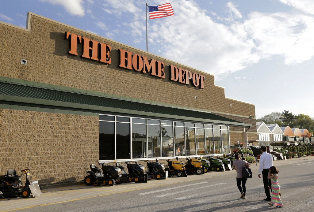 FILE - In this Wednesday, May 18, 2016, file photo, people approach an entrance to a Home Depot store in Bellingham, Mass. Home Depot is sticking by i