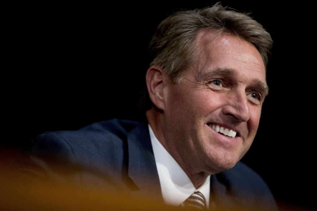 FILE - In this Oct. 31, 2017, file photo, Sen. Jeff Flake, R-Ariz., asks questions during a Senate Committee on Capitol Hill in Washington. Arizona ju