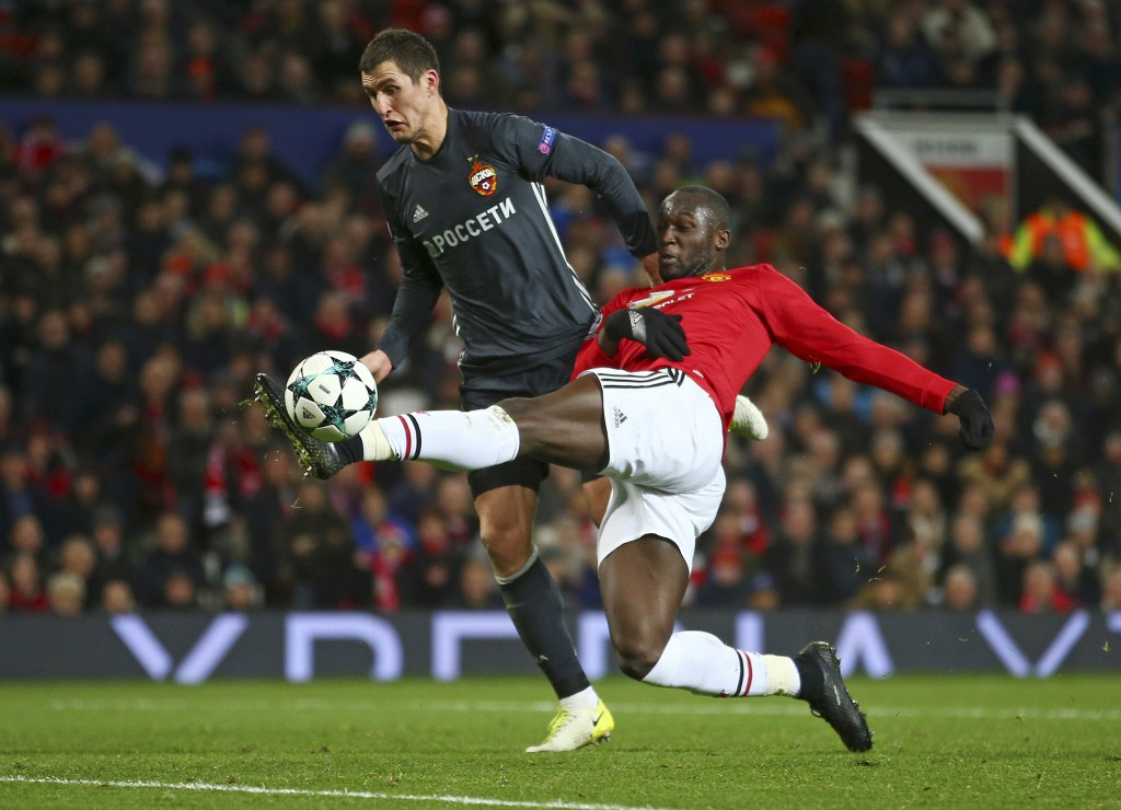 Manchester United's Romelu Lukaku, right, scores a goal as CSKA's Viktor Vasin tries to block during the Champions League group A soccer match between