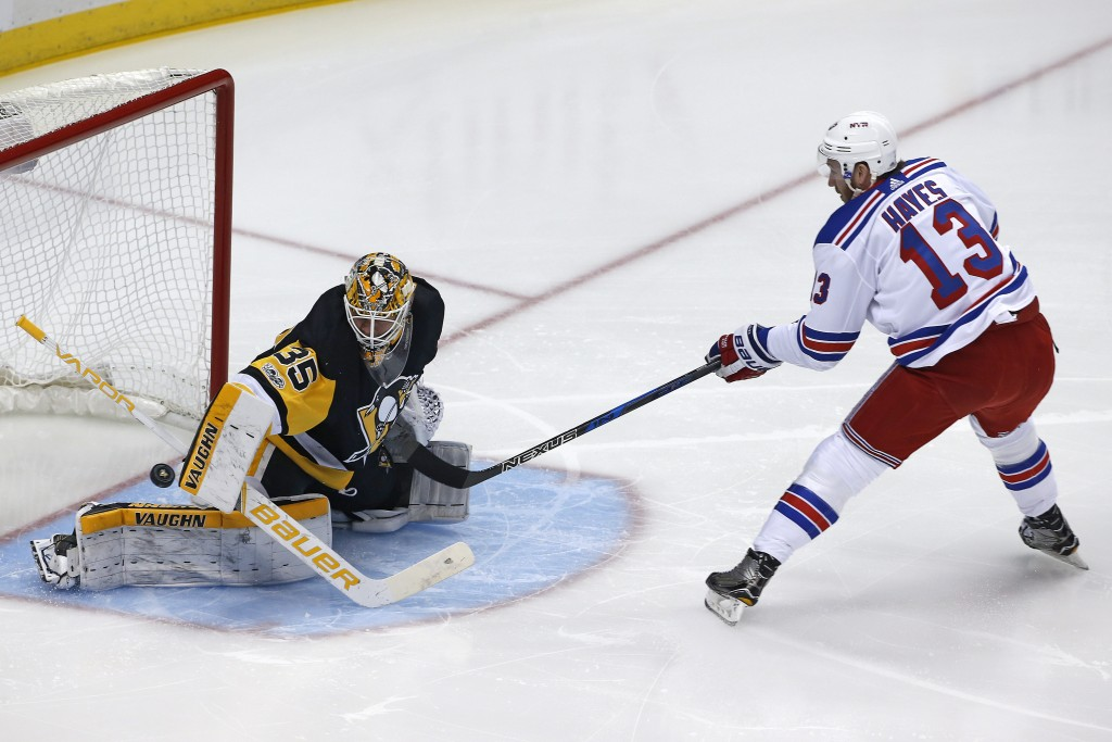 Pittsburgh Penguins goalie Tristan Jarry (35) stops a shot by New York Rangers' Kevin Hayes (13) on a breakaway during the first period of an NHL hock