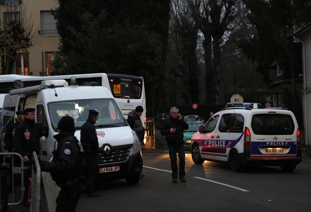 French riot police officers secure the area around Johnny Hallyday's house in Marnes-la-Coquette, outside Paris, Wednesday, Dec.6, 2017. Johnny Hallyd