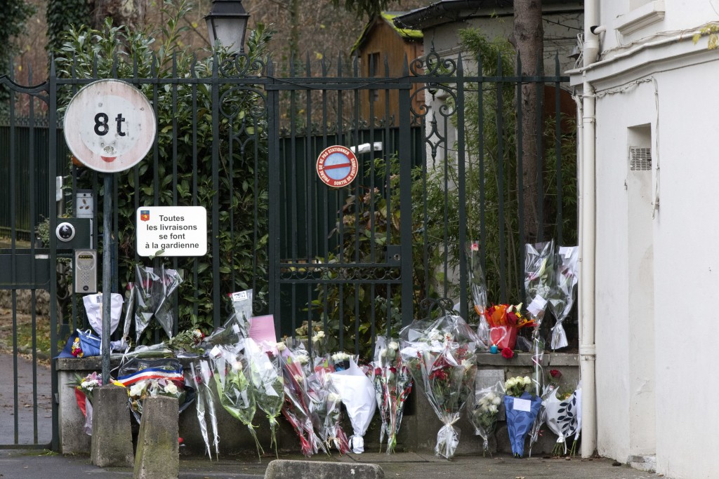 Flowers brought by fans lay outside Johnny Hallyday's house in Marnes-la-Coquette, outside Paris, Wednesday, Dec.6, 2017. Johnny Hallyday, France's bi