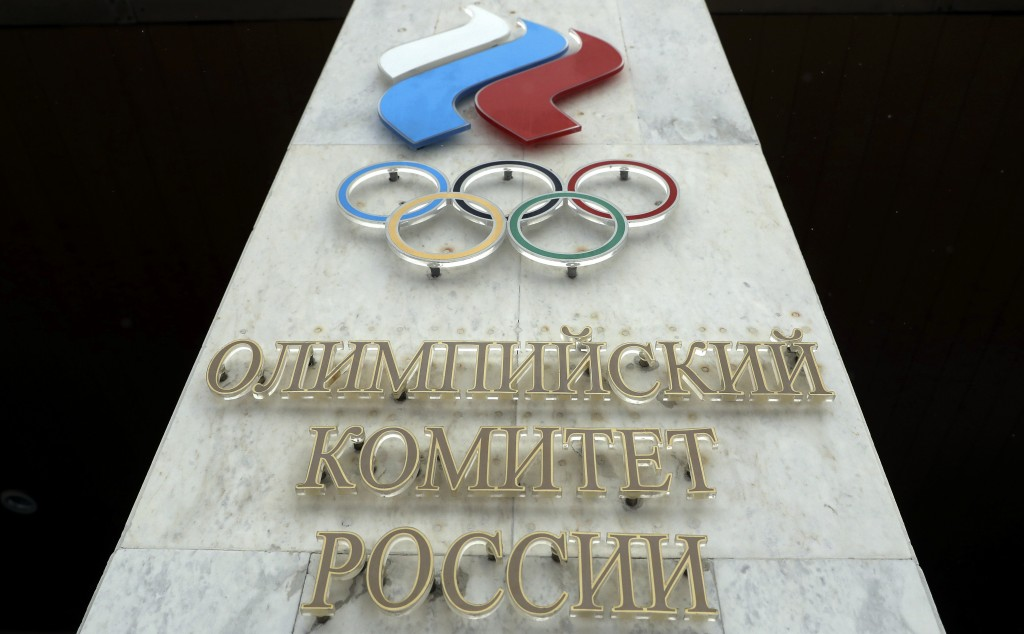 The logo of the Russian Olympic Committee is mounted at the entrance of the head office in Moscow, Russia, Wednesday, Dec. 6, 2017. The International