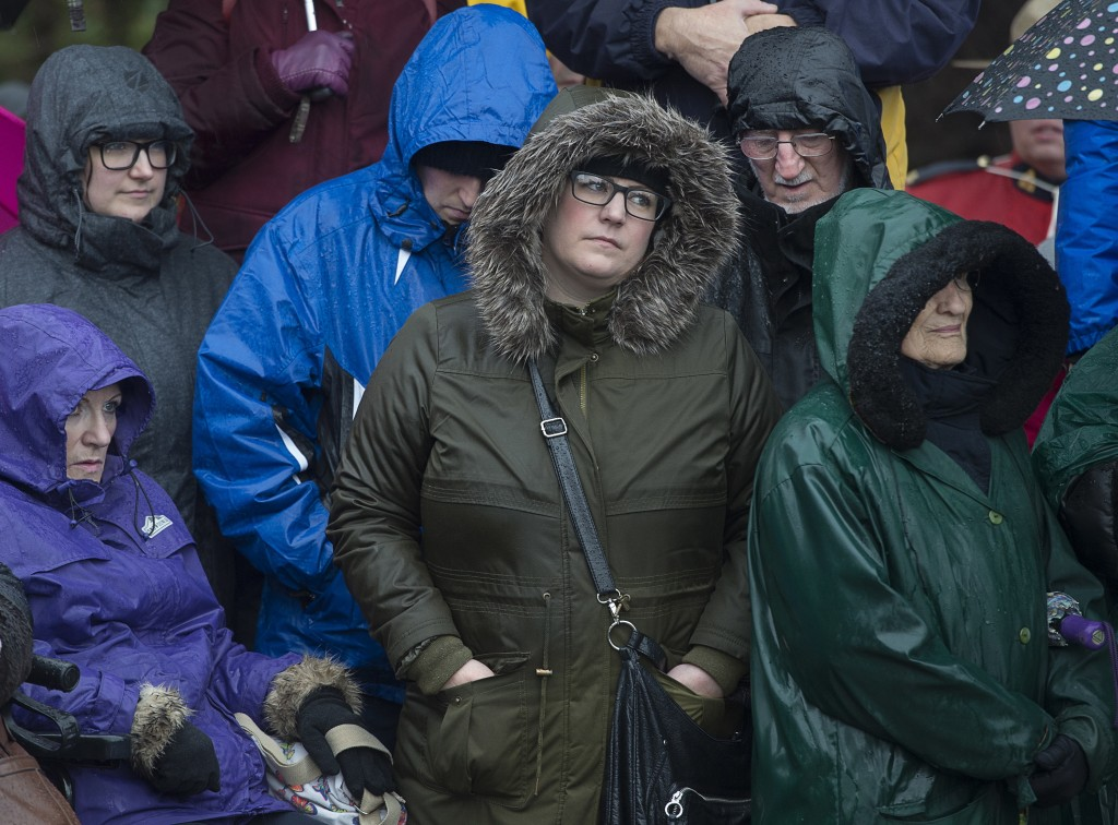 Residents and visitors brave the elements at a ceremony to mark the 100th anniversary of the Halifax Explosion at Fort Needham Memorial Park in Halifa