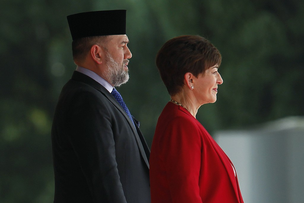 Governor-General of New Zealand, Dame Patsy Reddy, right, stands next to Malaysia's King Muhammad V before inspects a honor guard during a welcome cer