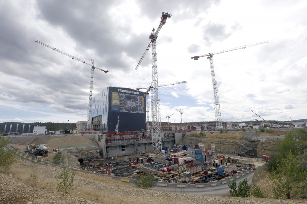 FILE - In this Sept. 15, 2016 file photo, cranes stand at the construction site of the ITER ( the International Thermonuclear Experimental Reactor) in