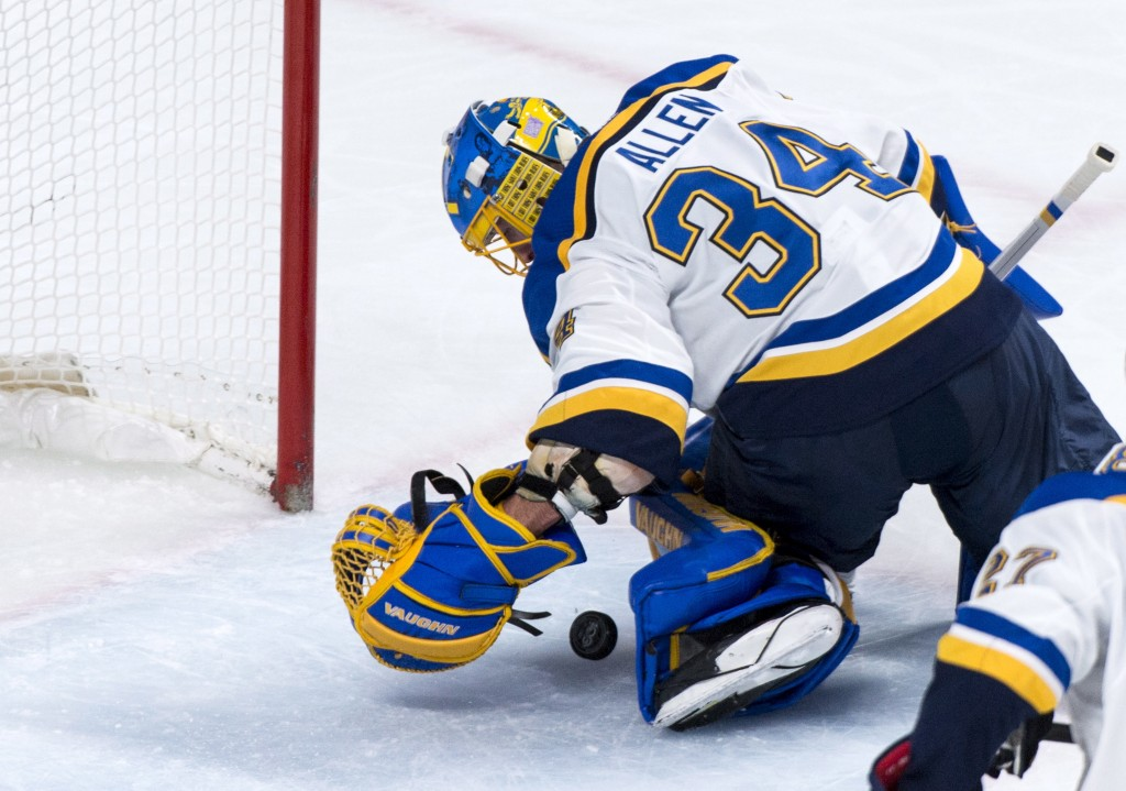 St. Louis Blues goalie Jake Allen stops the puck rolling towards the net during the first period of an NHL hockey game against the Montreal Canadiens,