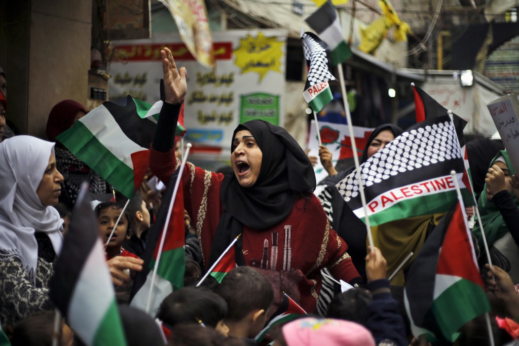 A woman chants slogans during a sit-in in the Bourj al-Barajneh Palestinian refugee camp in Beirut, Lebanon, Wednesday, Dec. 6, 2017. President Donald