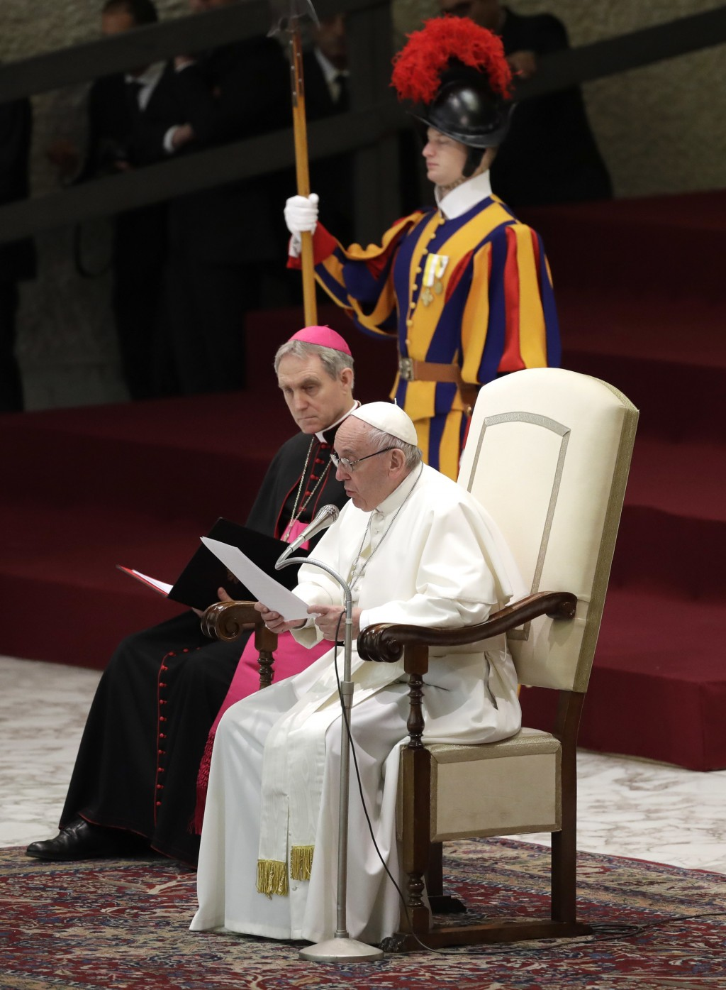 Pope Francis reads a statement during his weekly general audience in the Paul VI Hall at the Vatican, Wednesday, Dec. 6, 2017. Pope Francis called Wed
