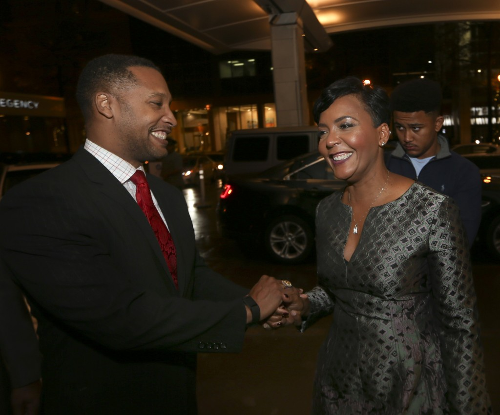 Atlanta mayoral candidate Keisha Lance Bottoms, right, is greeted by a well wisher as she arrives for an election-night watch party Tuesday, Dec. 5, 2