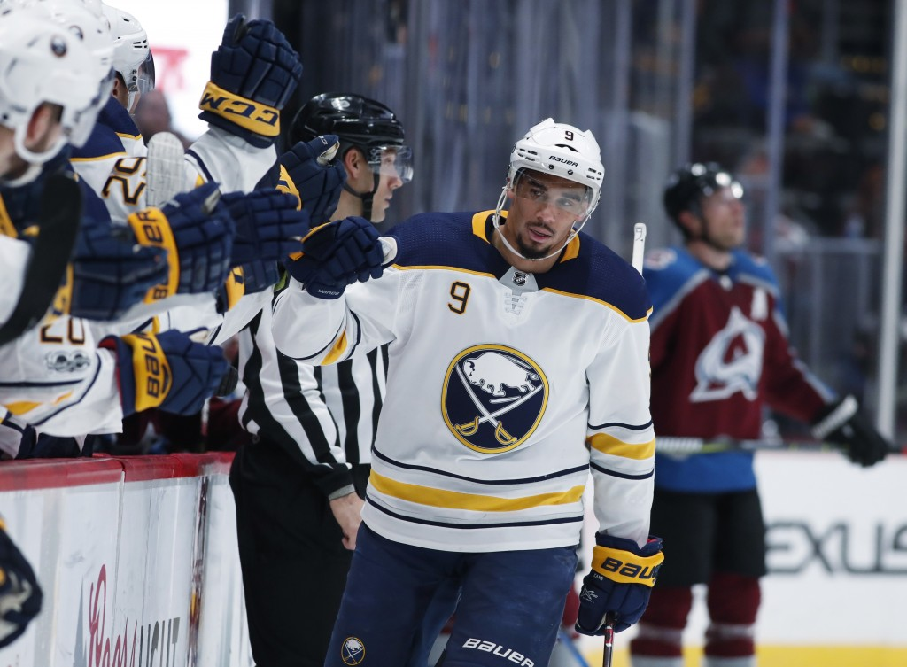 Buffalo Sabres left wing Evander Kane is congratulated as he passes the team box after scoring a goal against the Colorado Avalanche during the third