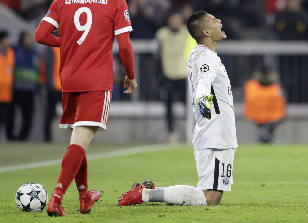 PSG goalkeeper Alphonse Areola reacts after Bayern scored their third goal during the Champions League Group B soccer match between FC Bayern Munich a