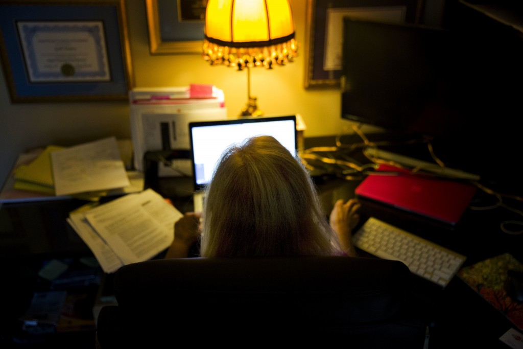 In this Monday, Dec. 4, 2017, photo, Gail Trauco, owner of The PharmaKon, looks over insurance documents on her computer in Peachtree City, Ga. Many s