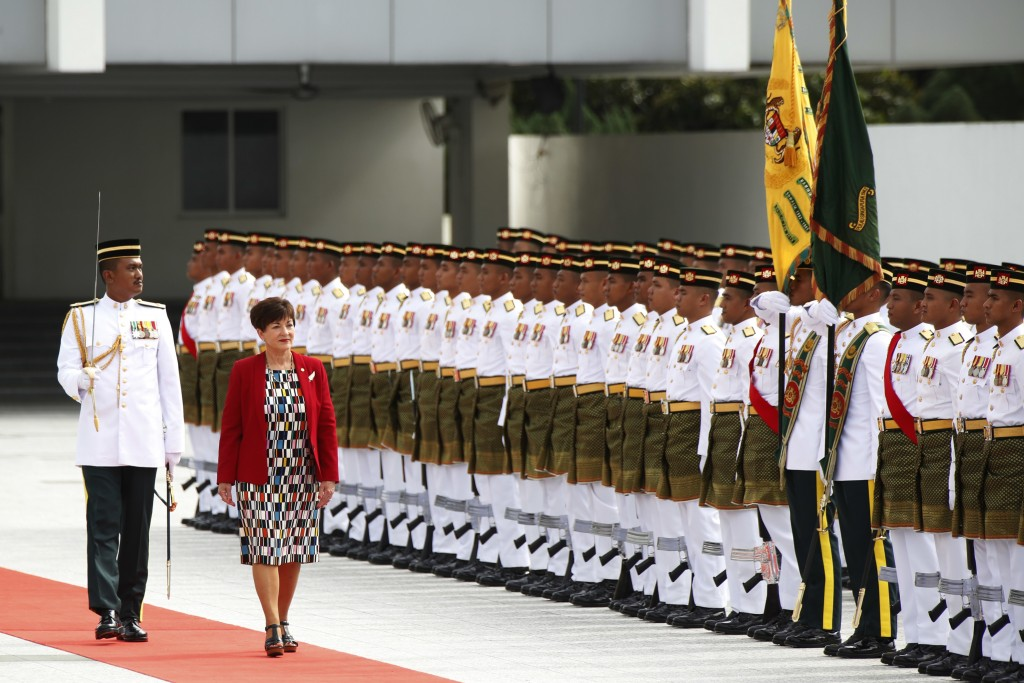New Zealand's Governor-General Dame Patsy Reddy, second left, inspects an honor guard during a welcome ceremony at parliament house in Kuala Lumpur, M