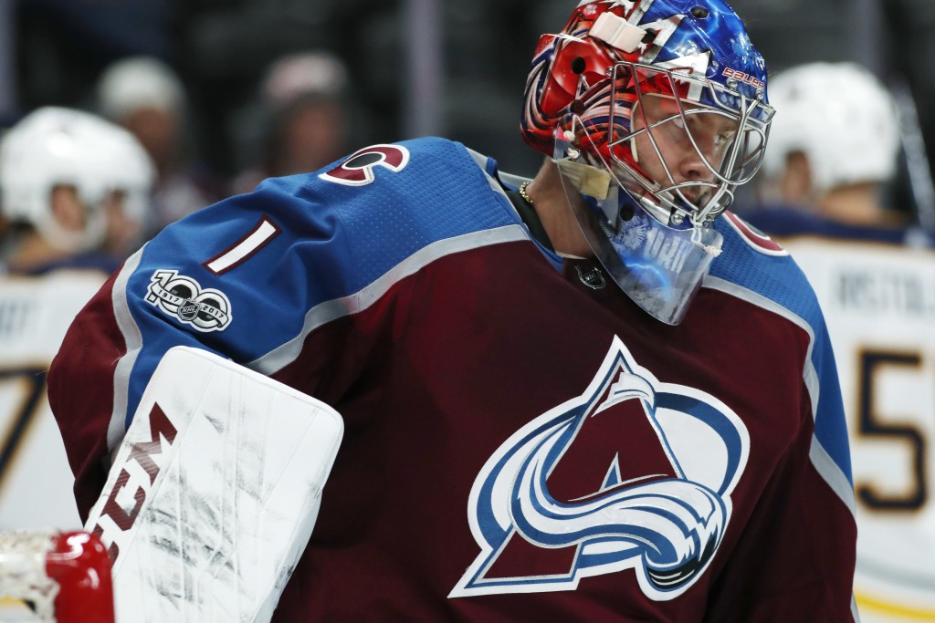 Colorado Avalanche goalie Semyon Varlamov, front, of Russia, reacts after giving up a goal to Buffalo Sabres left wing Benoit Pouliot in the second pe