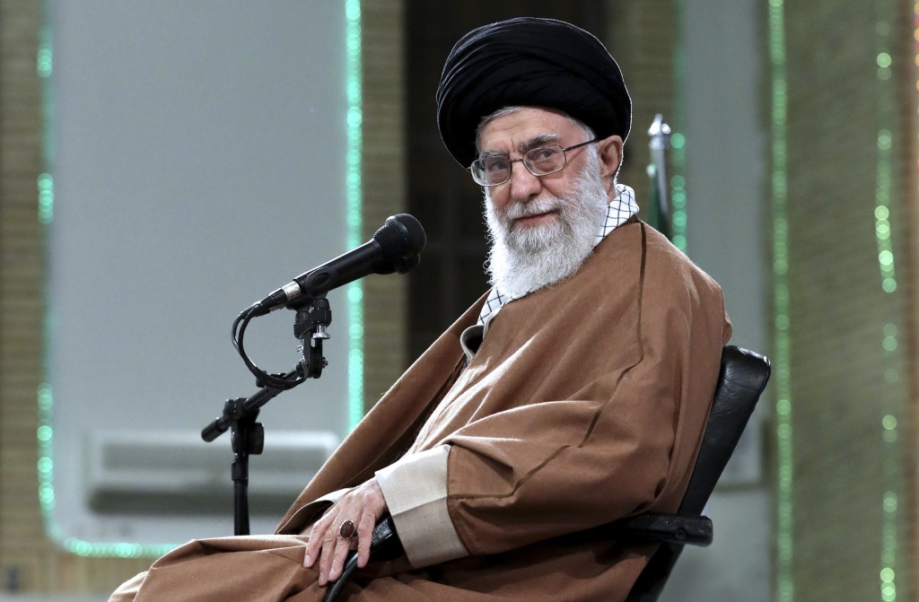 In this photo released by an official website of the office of the Iranian supreme leader, Supreme Leader Ayatollah Ali Khamenei  attends a meeting wi