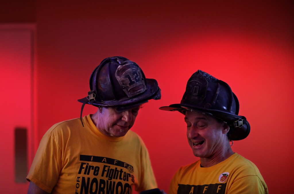 Retired Atlanta firefighters John Howe, left, and Keb Wyant, wait for returns to come in while attending an election night party in support of Atlanta