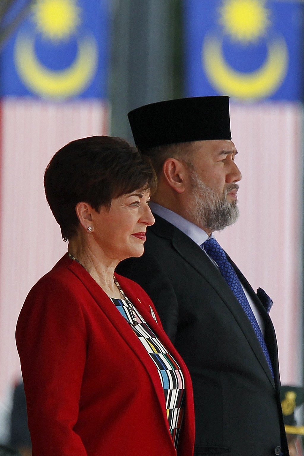 Governor-General of New Zealand, Dame Patsy Reddy, left, stands next to Malaysia's King Muhammad V before inspects a honor guard during a welcome cere