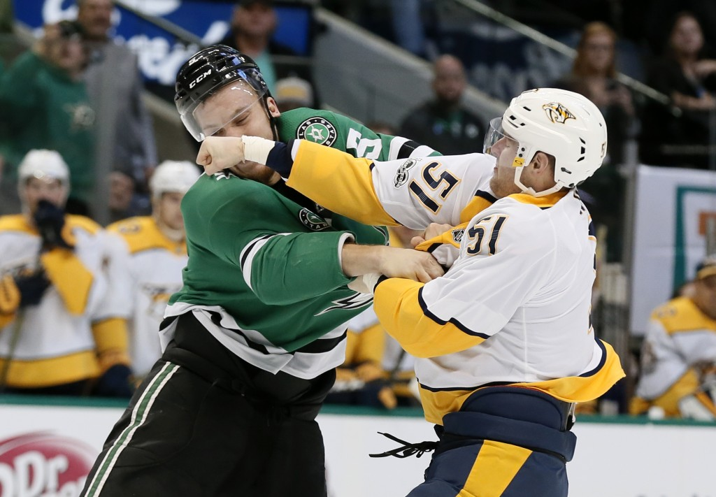 Dallas Stars defenseman Jamie Oleksiak (5) takes a punch from Nashville Predators left wing Austin Watson (51) during the second period of an NHL hock
