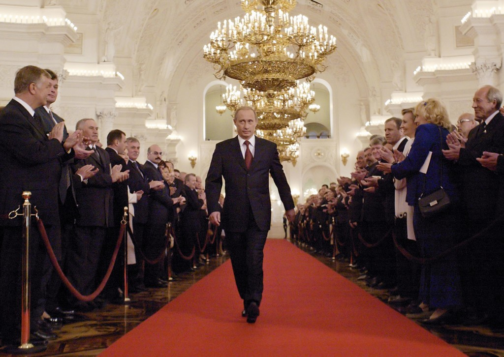 FILE- In this file photo taken on Friday, May 7, 2004, Russian President Vladimir Putin walks through St.George's Hall to take part in an inauguration