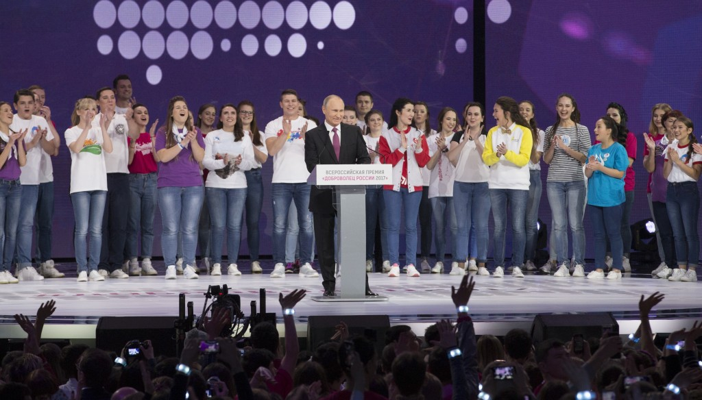 Russian President Vladimir Putin, center, arrives to attend at the annual Volunteer of Russia 2017 award ceremony at the Megasport Sport Palace in Mos