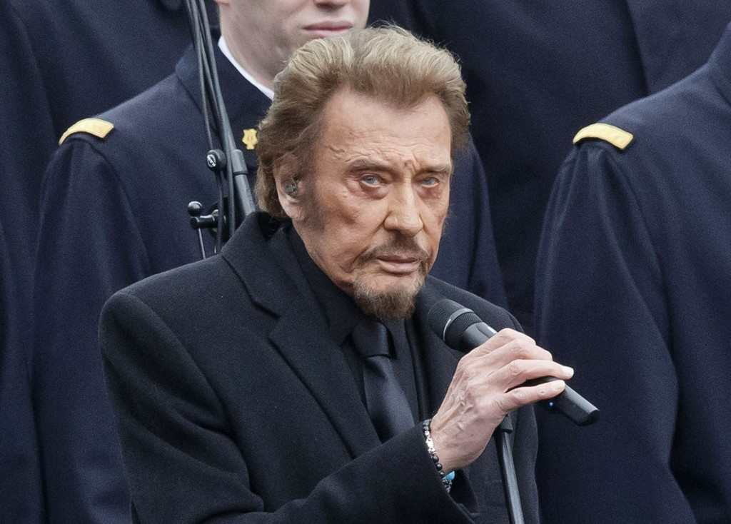 FILE - In this Jan. 10 2016 file photo, French rock star Johnny Hallyday sings during a ceremony to honor the victims of the Islamic extremist attacks