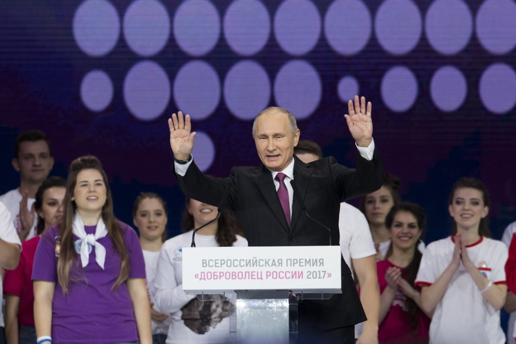 Russian President Vladimir Putin gestures as he speaks at the annual Volunteer of Russia 2017 award ceremony at the Megasport Sport Palace in Moscow,