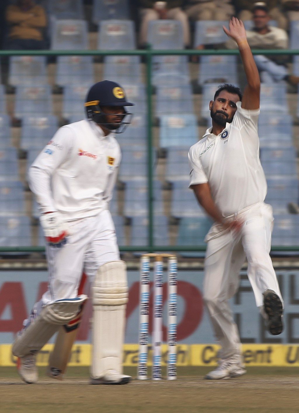 India's Mohammed Shami, right, bowls a delivery during the fifth day of their third test cricket match against Sri Lanka in New Delhi, India, Wednesda