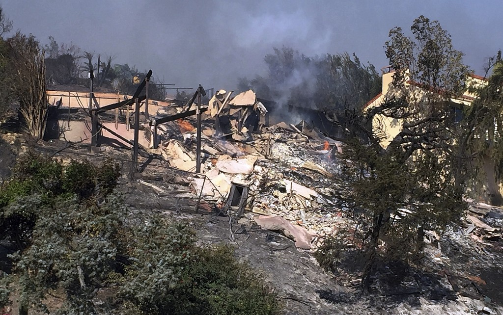 Bob Pazen's home is a smoldering ruin after after a wildfire swept through Ventura, Calif., Tuesday, Dec. 5, 2017. Pazen was in bed Monday night when