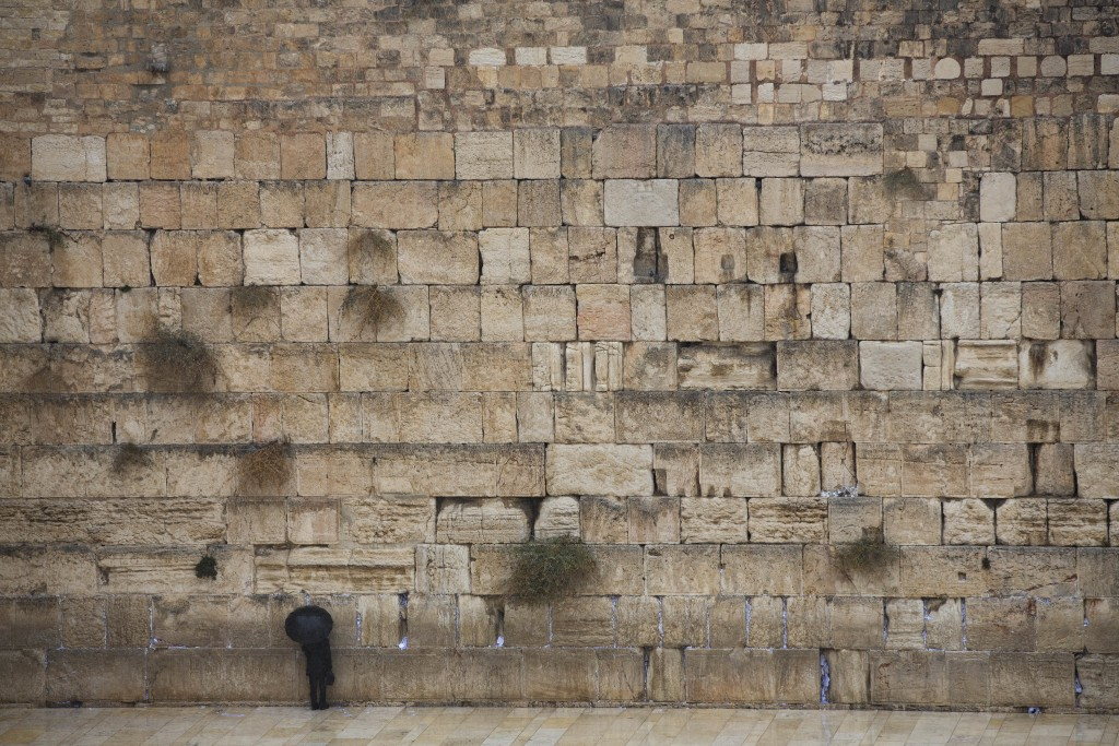 An Ultra-Orthodox Jewish man prays in front of the Western Wall, the holiest site where Jews can pray, in Jerusalem's Old City, Wednesday, Dec. 6, 201