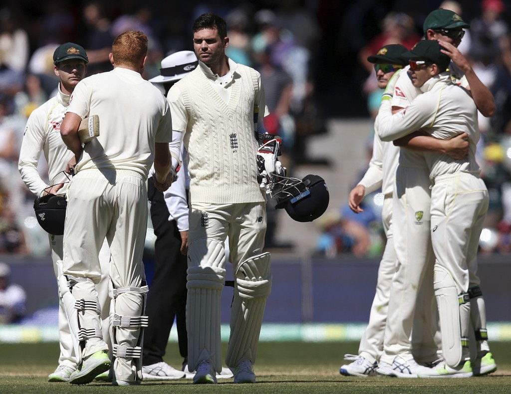 England's Jonny Bairstow, second left, and England's James Anderson, third left, shake hands as Australia's Steve Smith, left, comes toward them at th