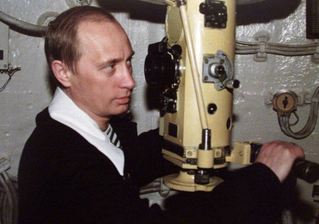 FILE - In this file photo taken in April 6, 2000, Russian President Vladimir Putin looks through the periscope of a nuclear submarine during a visit t