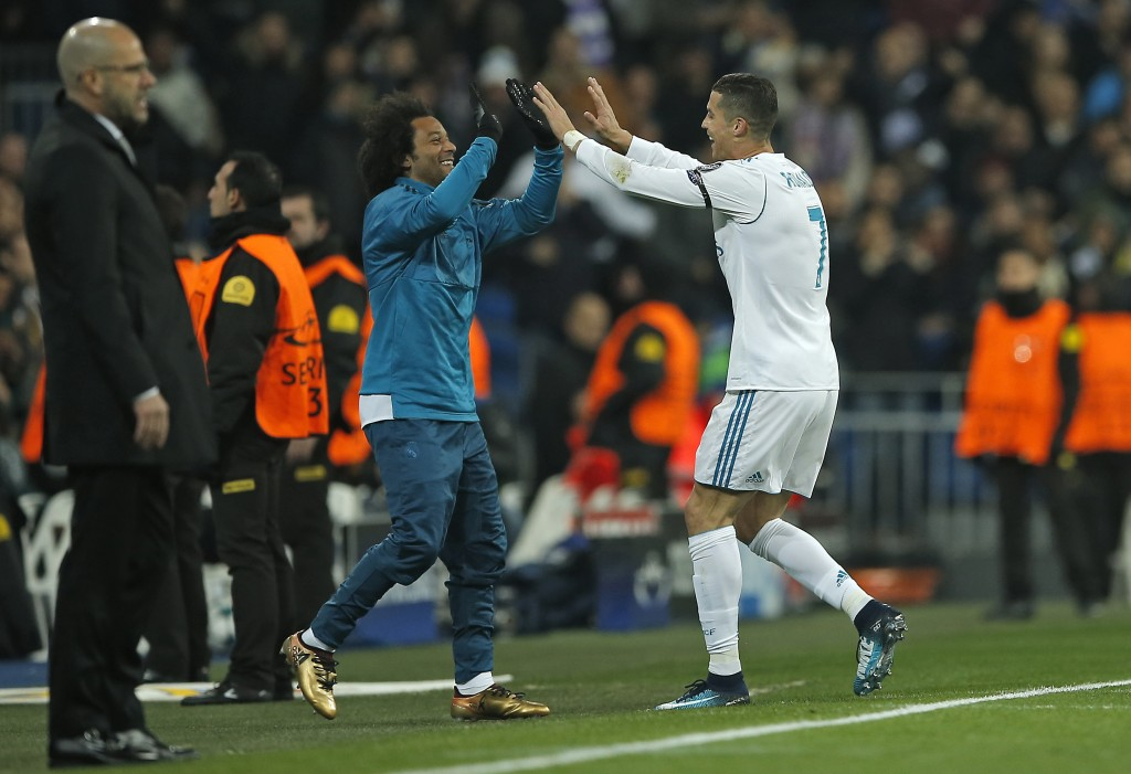 Real Madrid's Cristiano Ronaldo, right, celebrates with Real Madrid's Marcelo after he scored his side's second goal during the Champions League Group