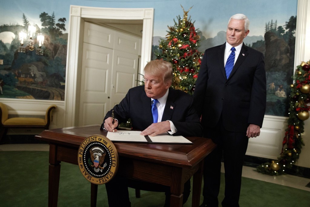 Vice President Mike Pence looks on as President Donald Trump signs a proclamation to officially recognize Jerusalem as the capital of Israel, in the D