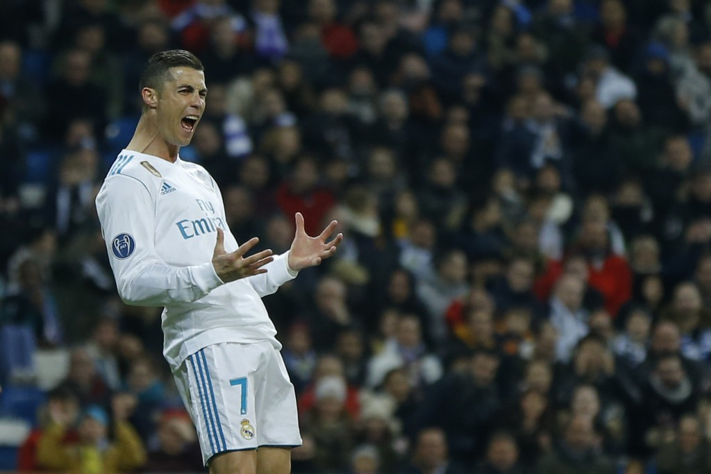 Real Madrid's Cristiano Ronaldo reacts after missing a chance to score during the Champions League Group H soccer match between Real Madrid and Boruss