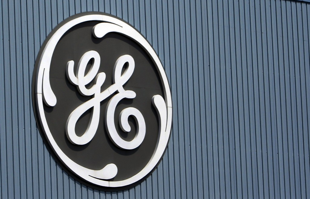 FILE - This June 24, 2014, file photo, shows the General Electric logo at a plant in Belfort, France. GE saw its stock price slump in 2017. (AP Photo/...