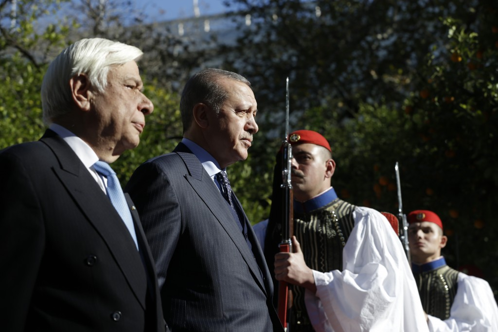 Greece's President Prokopis Pavlopoulos, left and Turkey's President Recep Tayyip Erdogan, centre, review the Presidential Guard during the welcome ce