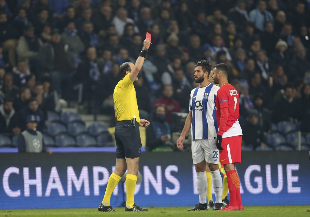 Referee Jonas Eriksson shows a red card to both Porto's Felipe, center, and Monaco's Rachid Ghezzal, right, during the Champions League group G soccer