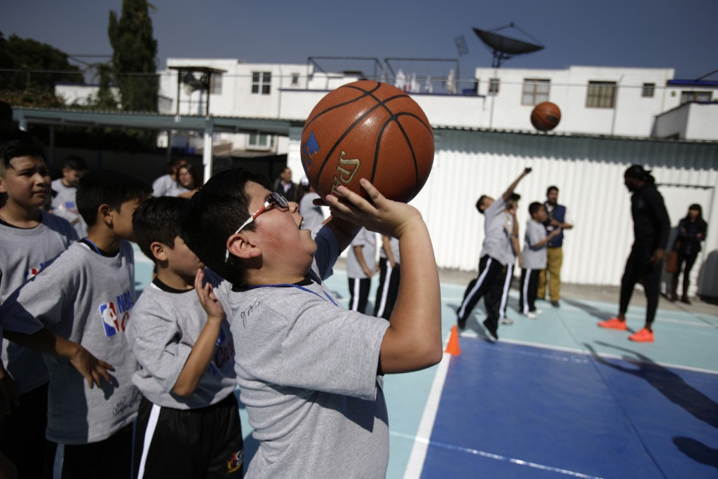 Students practice basketball skills with the Brooklyn Nets during an NBA Cares event at the Maestro Miguel A. Quintana Primary School in Mexico City,