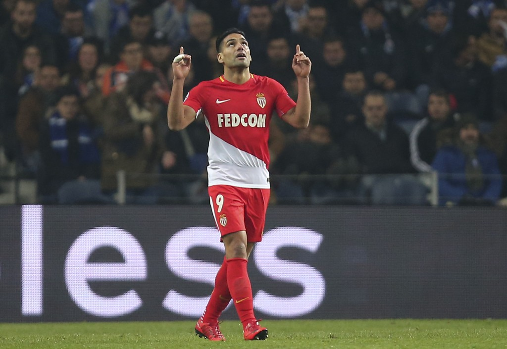 Monaco's Radamel Falcao gestures after scoring his side's second goal during the Champions League group G soccer match between FC Porto and AS Monaco