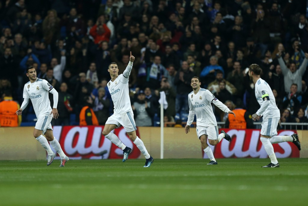 Real Madrid's Cristiano Ronaldo, center, celebrates after scoring his side's second goal during the Champions League Group H soccer match between Real