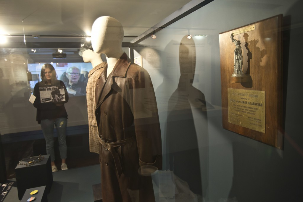 In this photo taken on Tuesday, Dec. 5, 2017, the coats of French Nazi hunter Serge Klarsfeld are displayed at the Shoah Memorial in Paris, France. Th