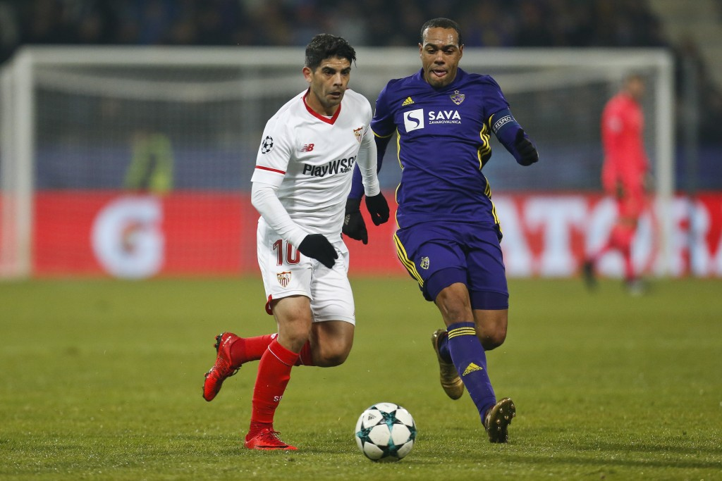 Sevilla's Ever Banega challenges for the ball Maribor's Marcos Tavares during the group E Champions League soccer match between Maribor and Sevilla at