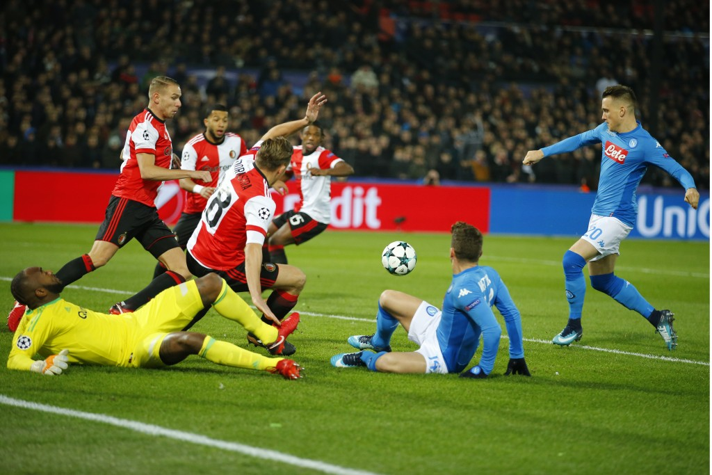 Napoli's Piotr Zielinski, right, scores the opening goal during a Champions League Group F soccer match between Feyenoord and Napoli at the Kuip stadi