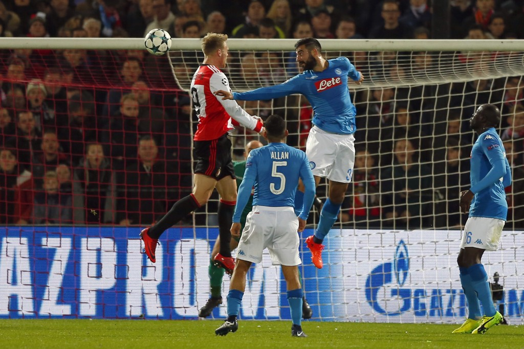 Feyenoord's Nicolai Jorgensen, left, heads the ball to score his side's first goal during a Champions League Group F soccer match between Feyenoord an
