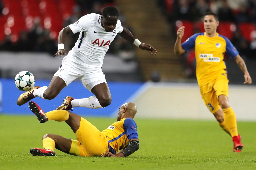 Tottenham's Moussa Sissoko, top, challenges for the ball by APOEL Nicosia's Carlao, below, during the Champions League Group H soccer match between To